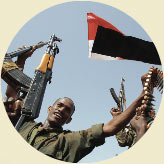 Man raising rifle and munitions