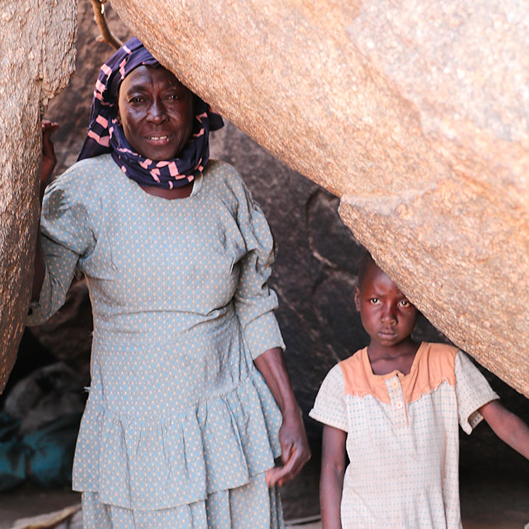 Woman and child hiding in cave