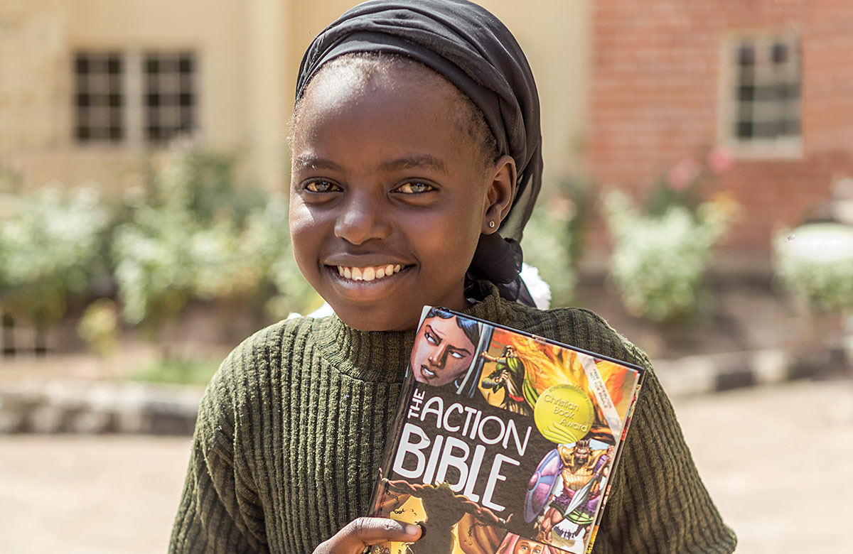 Girl holding action bible