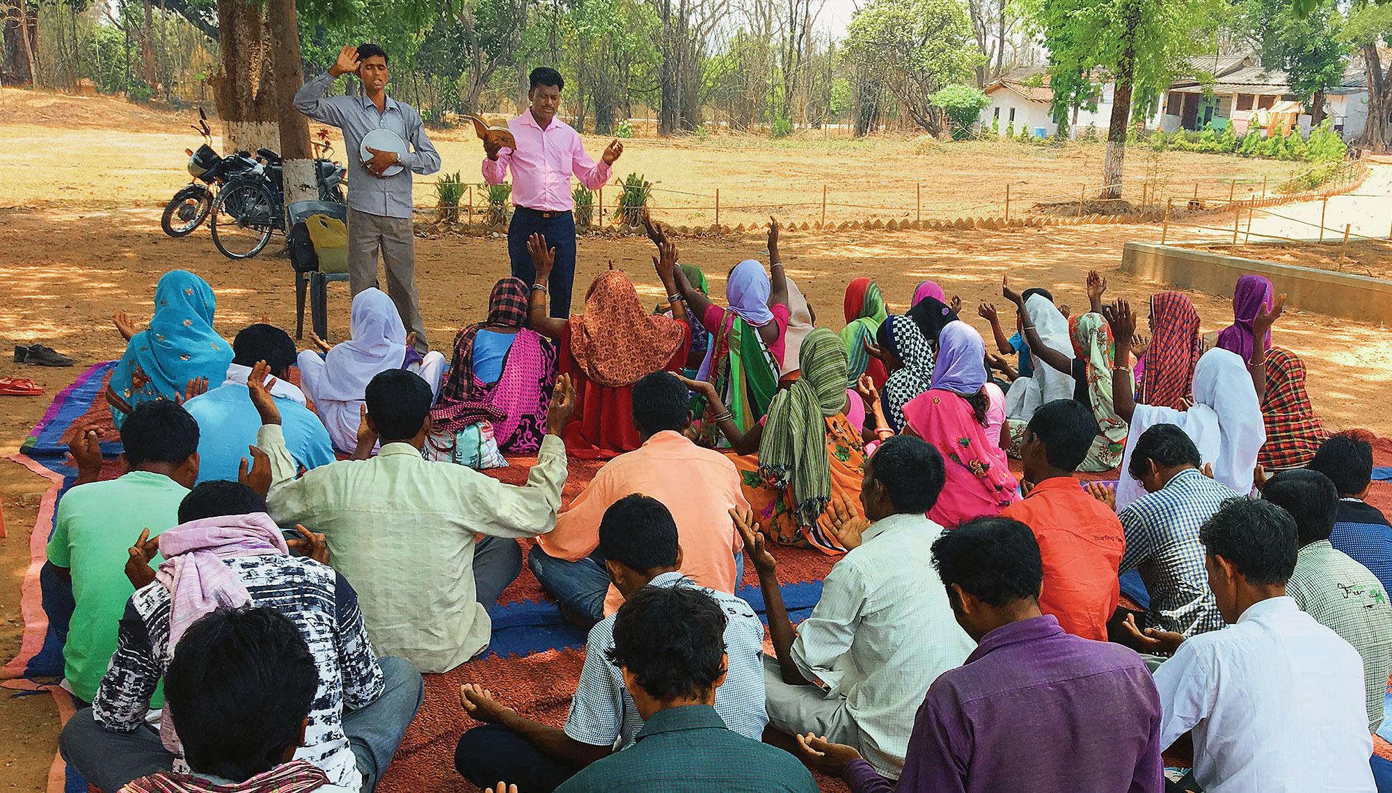 Group listening to speaker preaching