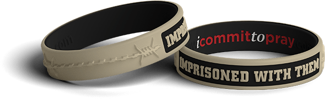 Wristband with 'imprisoned with them written' on the side