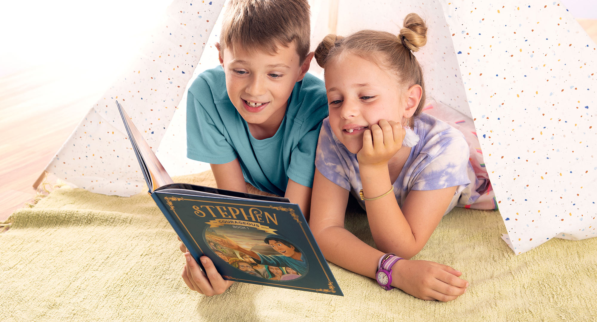 Two kids reading Stephen book