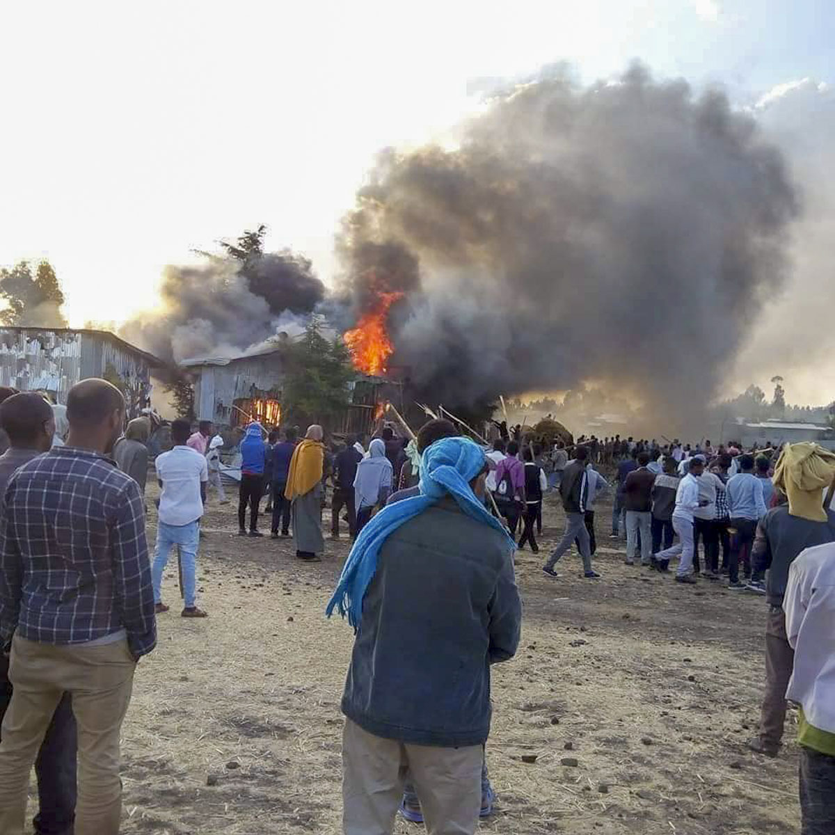Christians in northern Ethiopia watch their church building burn after an attack by members of the Ethiopian Orthodox Church