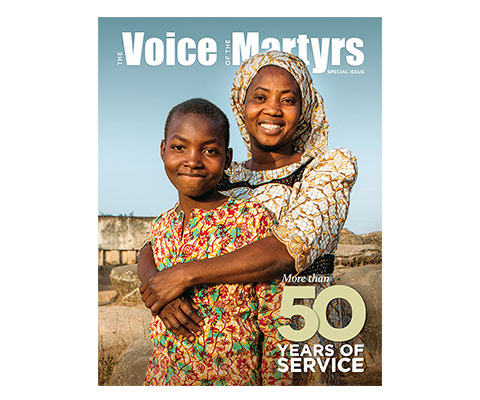 Cover of Newsletter with mother and child and title saying 50 Years of Ministry
