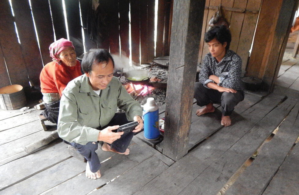 A family of three sit in their home reading